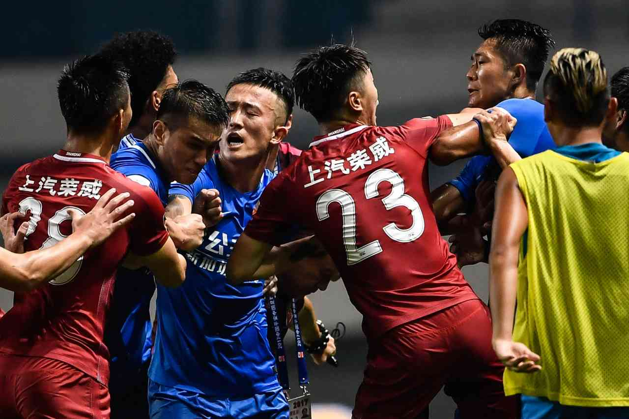 Oscar banned for 8 games over China Super League mass brawl