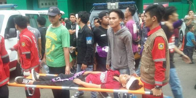 Indonesian supporter dies after mass brawl at stadium
