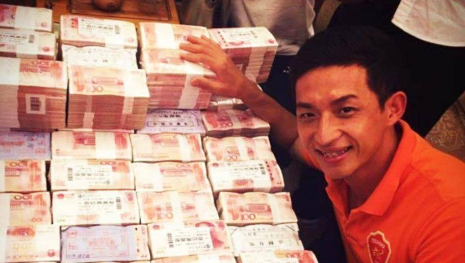 Chinese side Meixian Techand celebrate promotion by posing with mountain of cash