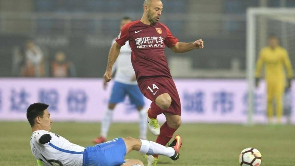 John Obi Mikel and Javier Mascherano in action as Tianjin Teda held by Hebei CFFC