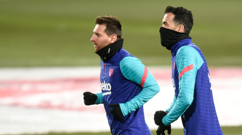 Lionel Messi and Sergio Busquets of FC Barcelona during the La Liga match between SD Huesca and FC Barcelona played at El Alcoraz Stadium on January 3, 2021 in Huesca, Spain.