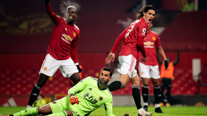 Edinson Cavani of Manchester United reacts to a chance on goal during the Premier League match between Manchester United and Wolverhampton Wanderers at Old Trafford on December 29, 2020 in Manchester, United Kingdom.