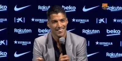 Suarez yang emosional dan bermata air mata bangga telah bersinar bersama Messi ketika menuju ke Atletico